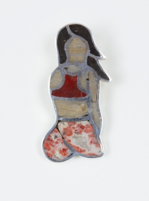Over-the-Shoulder Glance, approx. 1.5 x 0.5 in., sterling silver pendant with hand-cut black and tan petrified wood, jasper, and brecciated agate, 2019